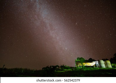 Milky way on sky with house foreground