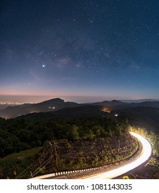 The milky way on a starry night and Doi Hua Sua with the beam of the passing car, Inthanon viewpoint, Chaingmai Thailand