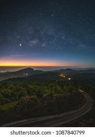 The milky way on a starry night and Doi Hua Sua, moments before the sun rises, Inthanon viewpoint, Chaingmai Thailand
