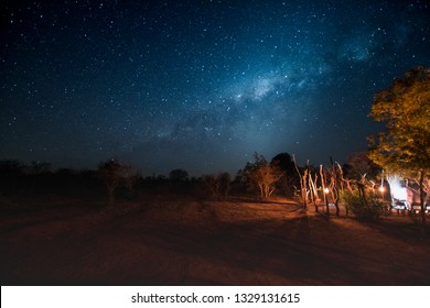 Milky Way over African bush camp with bonfire in Kruger Nationalpark, South Africa
