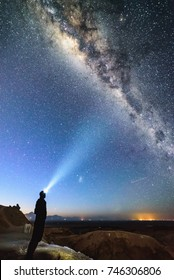 Milky way over the Atacama desert with man (me) stood with head torch overlooking