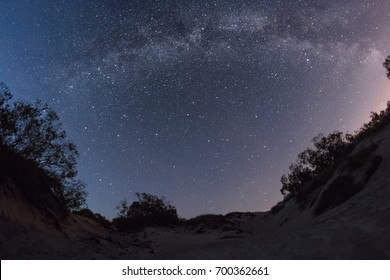 Milky Way over the Baltic sandy beach. Fisheye.
