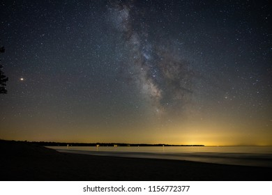 Milky way over a body of water