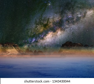 Milky Way over clouds and mountains. The Dolomites in Modonna di Campiglio, Italy.