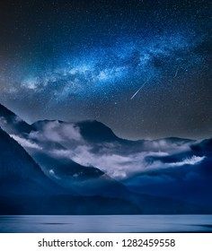 Milky way over fogged mountains in the morning