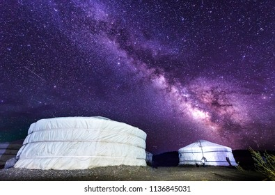 Milky way over ger camp in Mongolia gobi desert. Millions of stars in the sky at night in Mongol desert at a ger tent camp. Beautiful night sky with stars and milkyway in Gobi desert.