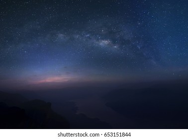 The Milky way over the Mae-Ping river in Lam-poon, Thailand.