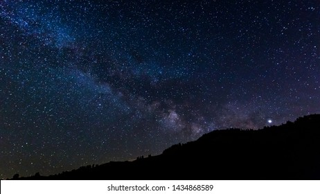 Milky way over mountain landscape
