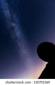 milky way over a radar installation in silhouette