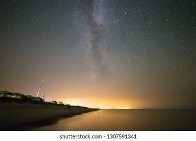 Milky Way over the sea shoreline.