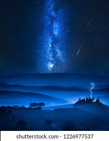 Milky way over the valley with small house in Italy