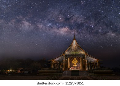 Milky Way over Wat Sirindhorn Wararam or Phu Prao Temple at night in Ubon Ratchathani,Thailand.beautiful temple at night.