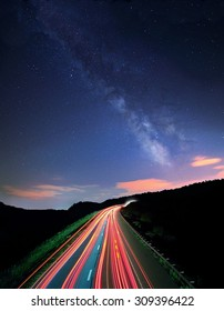 The Milky Way over the westbound lanes of I70 Ohio shot at a slow shutter speed, making the traffic to appear as streaks of light.