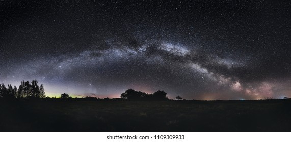 Milky way panorama in the fields