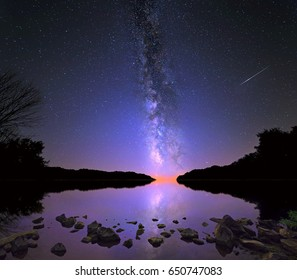The Milky Way and Perseid meteor over Salt Fork Lake, Ohio