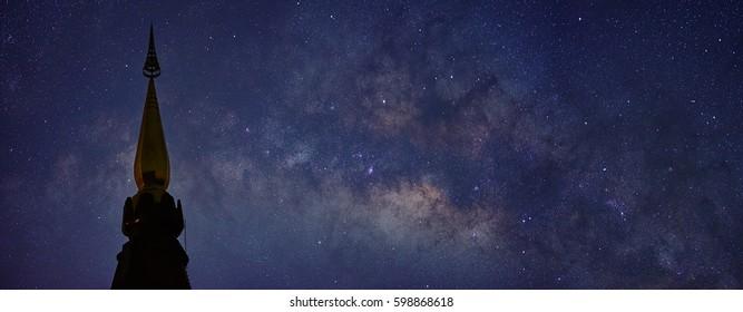 Milky way with Phra Mahathat Naphamethanidon pagoda in the foreground