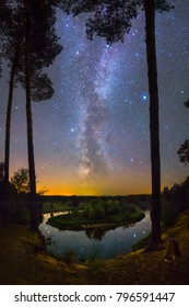 Milky Way and plenty of stars over beautiful landscape with river