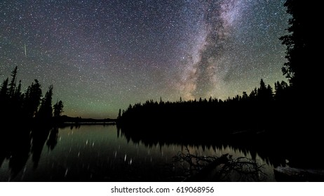 The milky way reflecting off the glass-like surface of Waldo Lake in Oregon.