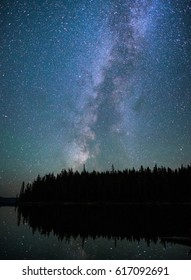 Milky way reflecting off the mirror-like surface of Waldo Lake