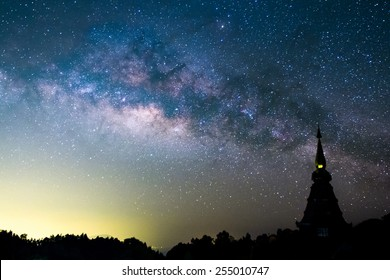 The  Milky Way rises over the silhouettes pagoda in Thailand.Long exposure photograph