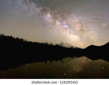 The milky way rising above Mt Hood in Oregon by Lost Lake Resort on a clear night in the spring.