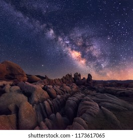 The Milky Way rising over the rugged and rocky terrain of joshua Tree national park is an awe inspiring sight