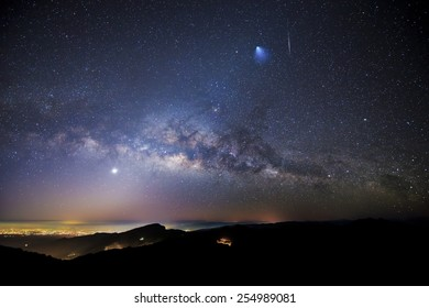 "Milky Way, Rocket, Meteor, Venus, and Zodiacal Lights over Doi Inthanon National Park, Chiang Mai, Thailand.  The blurry blue ""comet"" on the top right of the image is actually Ariane 5 rocket booster."