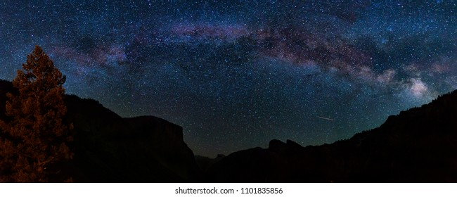 The Milky Way is seen spread out over the night sky over Yosemite National Park's iconic Tunnel View