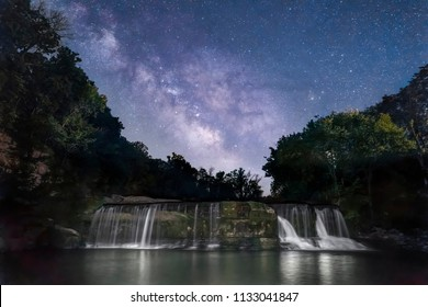 The Milky Way shines brightly in the dark rural Indiana sky over Owen County, Indiana's Upper Cataract Falls.