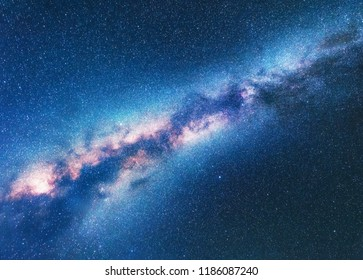 Milky Way. Space background with starry sky. Fantastic night landscape with bright milky way, blue sky full of stars. Shiny stars. Beautiful scene with universe. Astrophotography. Galaxy