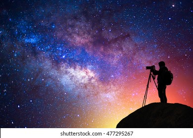 milky way, star, silhouette camera man on the mountain with detail of the milky way
