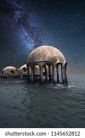 Milky way stars across a night sky over the Cape Romano dome house ruins in the Gulf Coast of Florida