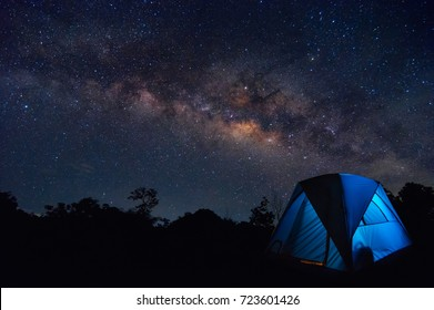 Milky Way with stars and tent in foreground, Family camping in the North Thailand, Lampang.