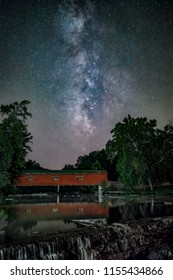 The Milky Way stretches across the night sky over Owen County, Indiana's Cataract Covered Bridge.