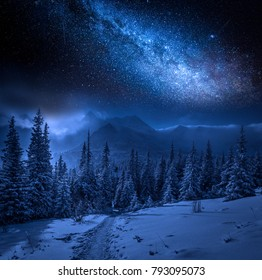 Milky way and Tatras Mountains in winter at night, Poland