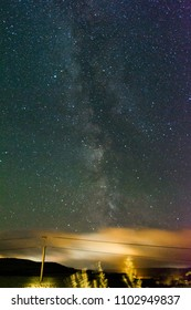 Milky Way and Telegraph Pole Over Rural Farmland