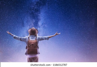 Milky Way. Tourist at the Universe background. Travelers with backpack at the night sky background. Adventure and travel concept