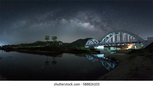 Milky way and white bridge in Lamphun,Thailand