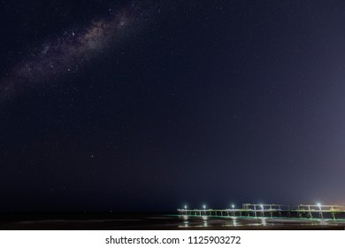 Milkyway in a clear night sky over the Gold Coast Spit jetty