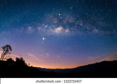 The Milkyway Galaxy Rise. Photo contain grains, blur and noise due to long exposure photography. - Shutterstock ID 1322725457