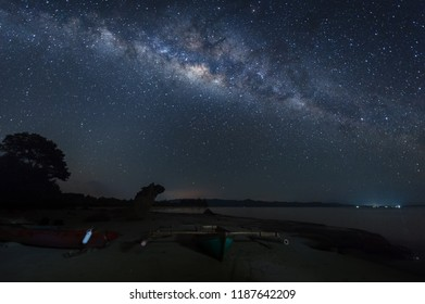milkyway gslaxy rise above Unknown beach at Kudat, Malaysia. soft focus and noise due to long expose and high iso.
