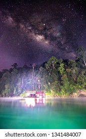 A milkyway with houseboat on the lake. Boat a bit overexposed due to light from the houseboat. Image contains a bit noise due to high ISO