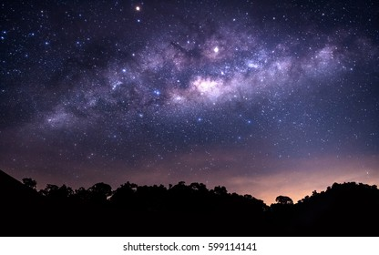 The milkyway , miracle night sky with  silhouette mountain ,copy space