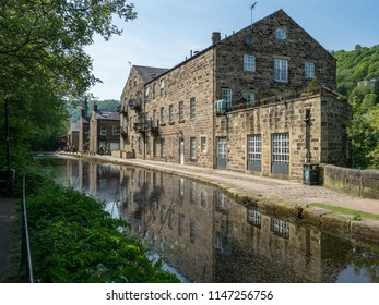 Mill buildings reflected in canal