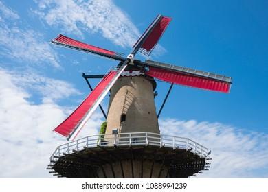 mill De Arend in Terheijden, The Netherlands, against blue sky
