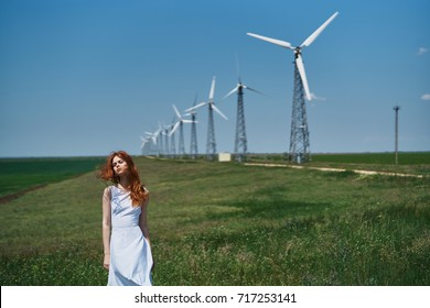 mill in the field, beautiful woman in white pile on fresh air, nature, sunny day