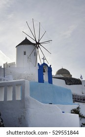 mill at traditional white village Oia Santorini