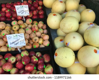 Mill Valley, California/USA - September 24, 2018: S jumble of apples and melons on sale outside the local grocer with hand printed signs