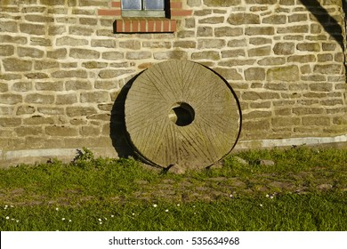 A mill wheel at the windmill Levern (Stemwede, Germany) taken just before sunset is part of the Westphalia Mill Street in the rural district Minden-Luebbecke.