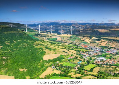MILLAU, FRANCE - JULY 03, 2016: Best locations of world, fabulous viaduct of Millau with agriculture fields, Aveyron region, France, Europe JULY 03, 2016 in Millau, France